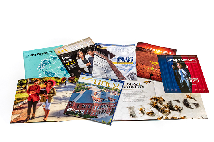 photo of various UNCG and Research magazine publications