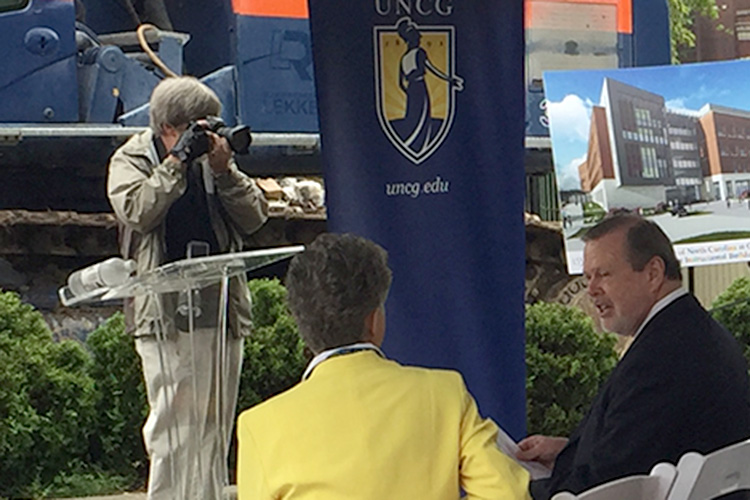 photo of photographer at UNCG event