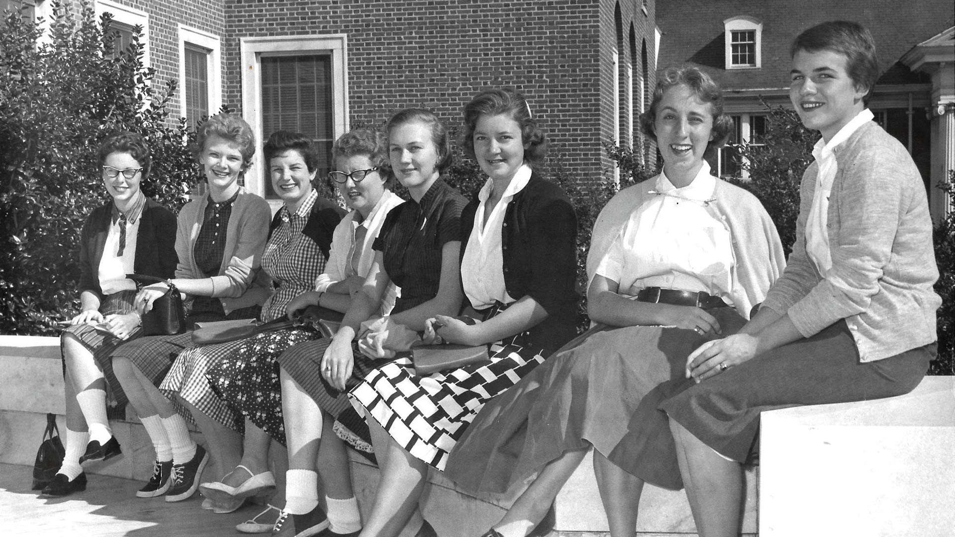 Emmy seated far right, with classmates on the steps of Jackson Library, Freshman Week, 1958.