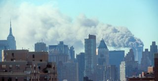 Skyline of Manhattan with smoke billowing from the Twin Towers following September 11th terrorist attack on World Trade Center, New York City. Sept. 11, 2001