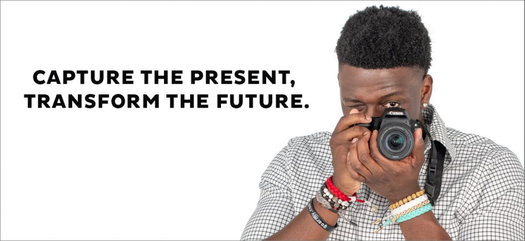 photo of brand story student, Dontae Burnette, holding a camera